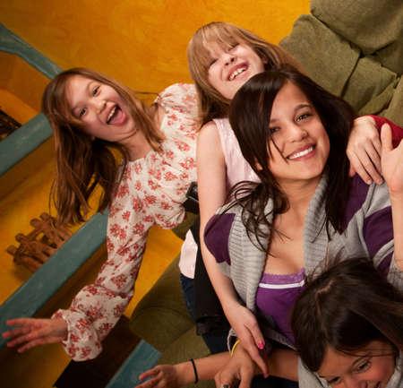 Group of six little girls enjoying their leisure  photo