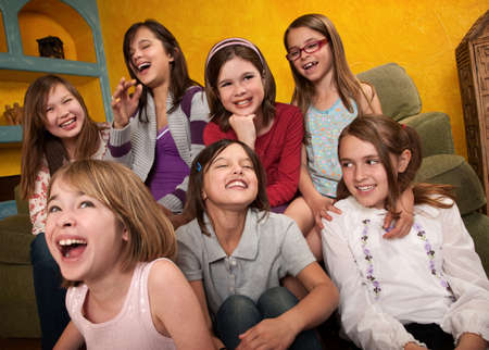 Group of seven happy little girls laugh out loud photo
