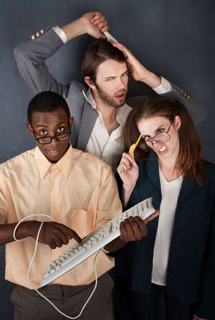 huh: African-American and Caucasian geeks make faces while another man combs his hair