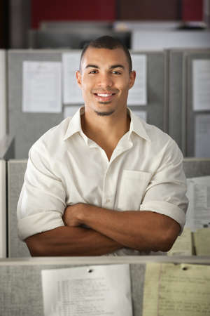 office cubicle: Confident Black male office worker with his arms folded  Stock Photo