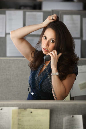 Busy Latina office woman on a phone call  photo