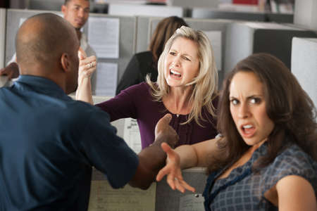 office chaos: Chaos between a group of coworkers in office  Stock Photo
