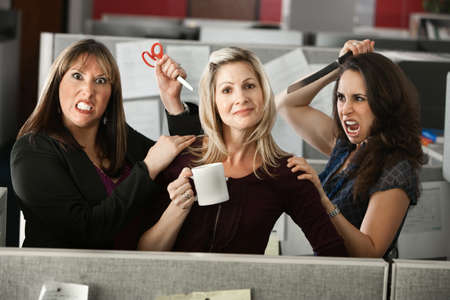 envy: back-stabbing colleagues threatening employee with scissors and knife  Stock Photo
