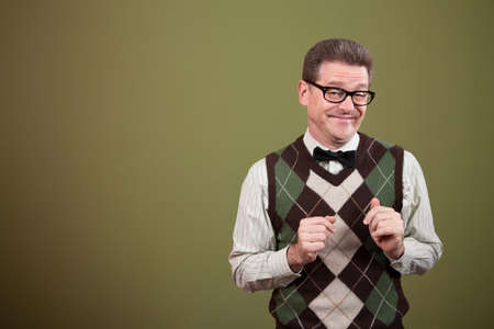 dweeb: Male nerd with bowtie makes a face