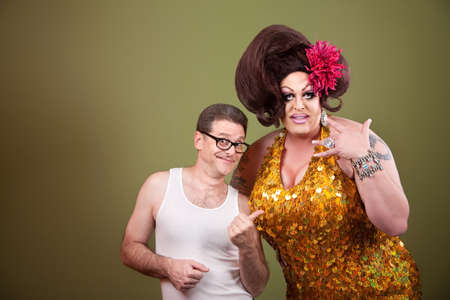 wifebeater: Caucasian man with drag queen on green background Stock Photo