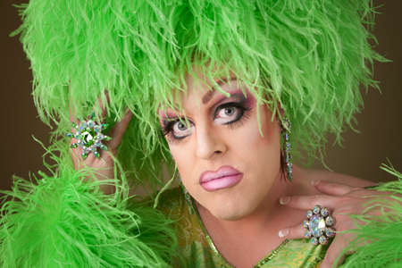 bbw: Serious drag queen in green dress with boa wig