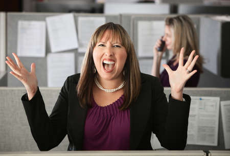big mouth: Frustrated woman office worker screaming with hands in air