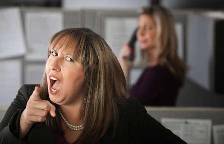 怒っている女性従業員人差し指 写真素材