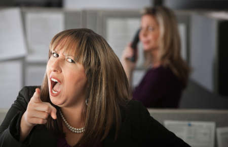 rude: Angry woman employee pointing index finger Stock Photo