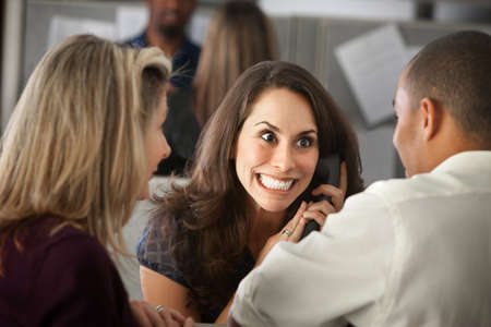 Excited woman office worker with colleagues on phone Stock fotó