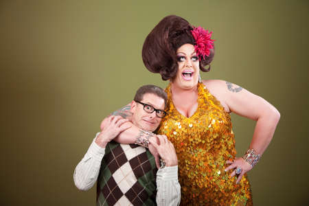 Large drag queen holds a surprised nerd around his neck photo