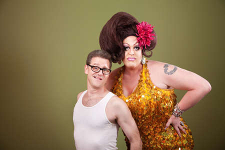 shorter: Tall drag queen with shorter man in glasses Stock Photo