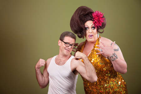 Short muscular man with impressed heavy-set drag queen  photo