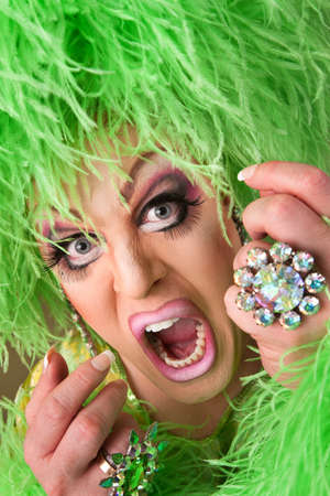 Scared drag queen wearing heavy makeup and boa hat  Stock Photo - 9738784