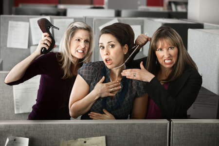 hate: Three women office workers quarrels in cubicle