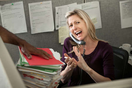 Woman office worker yells on a phone call photo