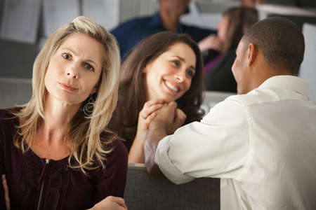 inappropriate: Woman envies coworkers love affair at in another cubicle Stock Photo