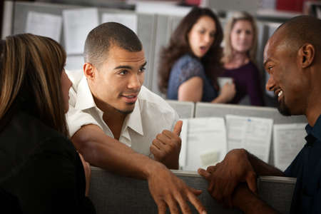 office cubicle: Office worker gossips about other lady in his cubicle