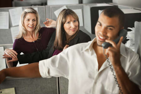 Women office workers flirt with handsome male coworker in office  photo