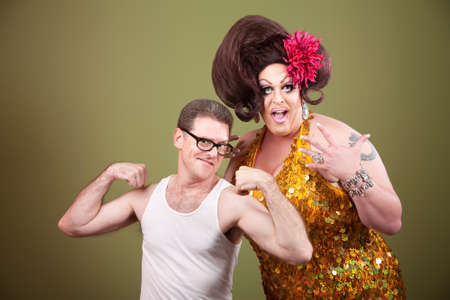 bbw: Short muscular man with impressed large drag queen Stock Photo