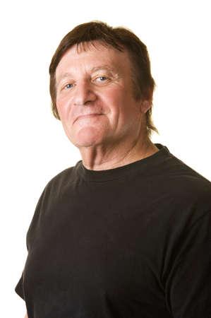 smirk: Confident mature Caucasian man smiles over white background