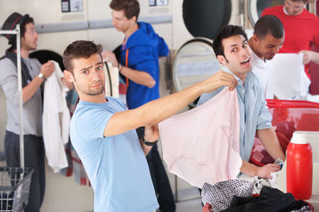 panties: Young Caucasian man holds large granny panties while another man laughs