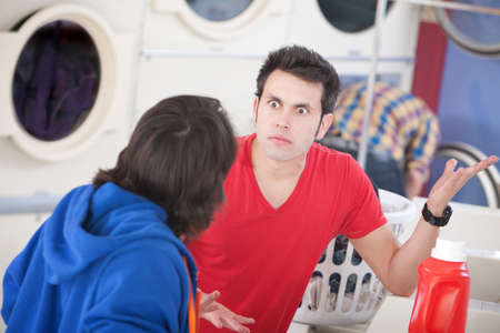 laundromat: Two young men argue in the laundromat