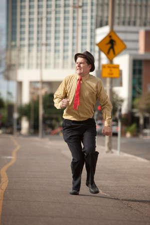 run down: Scared Caucasian businessman run down the street