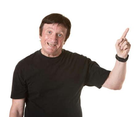 affirm: Mature man over white background points index finger upward