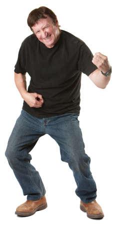 Energetic mature Caucasian man gestures to play guitar  Stock Photo