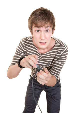 Young Caucasian man holds video game controller over white background photo