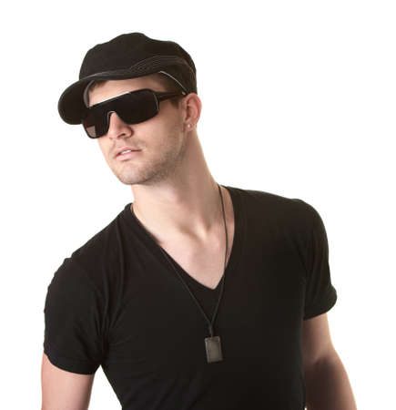 Trendy young Caucasian man with sunglasses over white background Stock Photo