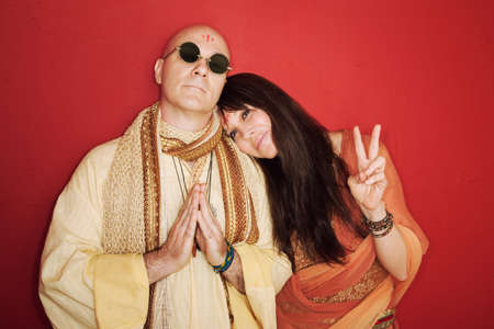 Pious guru prays with woman makes peace symbol Stock Photo - 10553286
