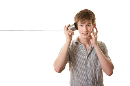 tin can phone: Young skinny Caucasian man with tin can phone over white background Stock Photo