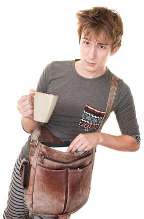 Teen with messenger bag and mug over white background Stock Photo - 10553255