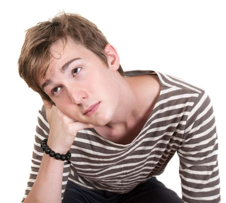 Bored Caucasian teen with hand on chin over white background Stock Photo - 10553245