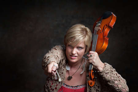 snatch: Caucasian female hands over earbuds while snatching a violin