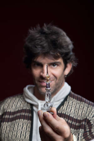 warlock: handsome caucasian warlock holds magic potion bottle