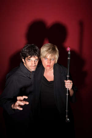sceptre: Scary pagan couple in black with sceptre Stock Photo