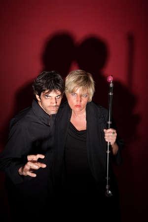 pohanský: Scary pagan couple in black with sceptre Reklamní fotografie