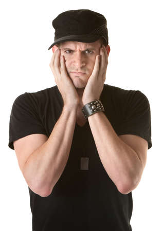 mope: Unhappy young Caucasian man with hands on face over white background