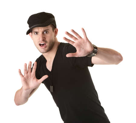 Scared young Caucasian man over white background with hands up 免版税图像