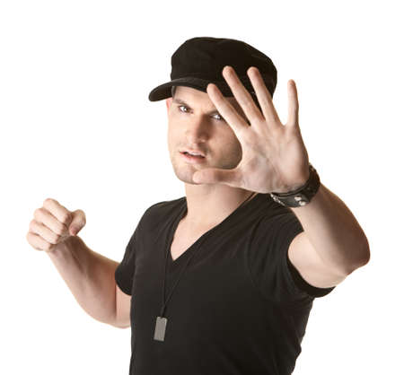 brawl: Young Caucasian man showing fist and open hand over white background