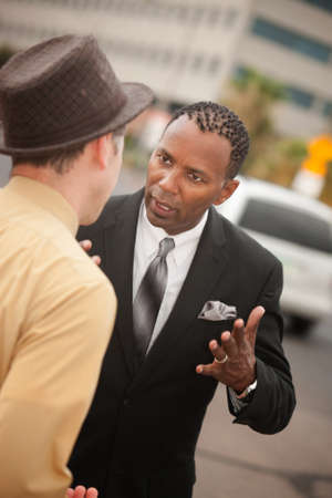 Handsome African-American businessman arguing with his colleague photo