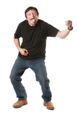 air guitar: Mature Caucasian over white background man sticks his tongue out