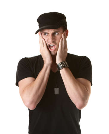 Scared young man with hands on face over white background photo