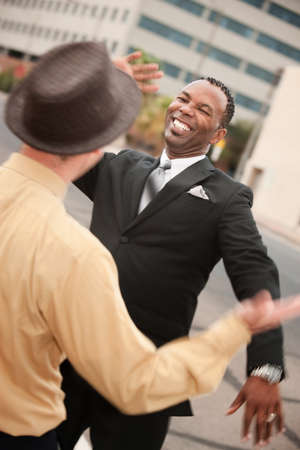 five people: Two successful businessmen high five each other