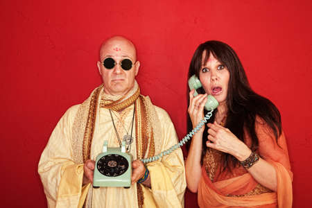 guru: Shocked and disappointed hippies over maroon background