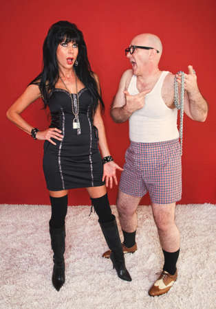 Dominatrix woman is annoyed as her client complains to her. photo