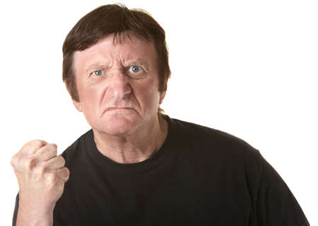 hefty: Angry mature Caucasian man with clenched fist over white background